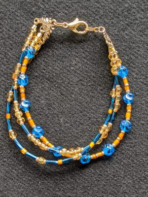 three strand gold & bright blue bracelet